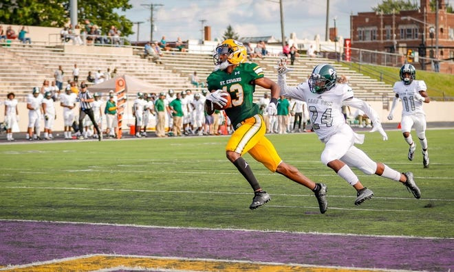 Montorie Foster of St. Edward races in for a touchdown against Cass Tech during the 2019 season. Foster only played one year of high school football, and earned a scholarship from Michigan State.