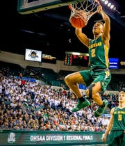 Montorie Foster of St. Edward finishes a slam dunk in the Division 1 regional finals.