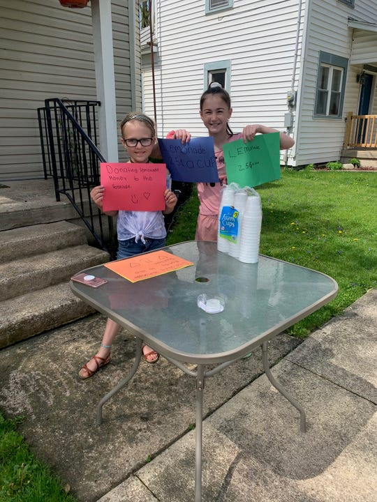Spencer Mott, 8, and Addie Shields, 11, told lemonade in Lucas to raise money for pizza parties for ER staff at three local hospitals Sunday.