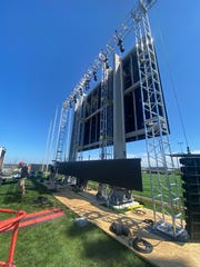 The screen is going up at the new Milky Way Drive-In, a pop-up outdoor movie theater opening Friday at Ballpark Commons in Franklin.