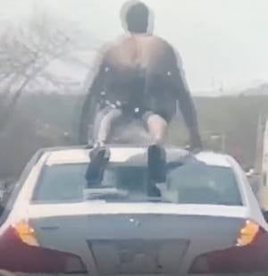 Milwaukee police are asking for the public's help as it investigates a video circulating on social media of a man doing push-ups atop a moving vehicle.
