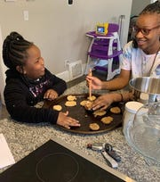 Amanda Davis' daughters, 6-year-old Honor and 12-year-old Serenity, make cookies after an at-home school lesson on fractions during the coronavirus pandemic.