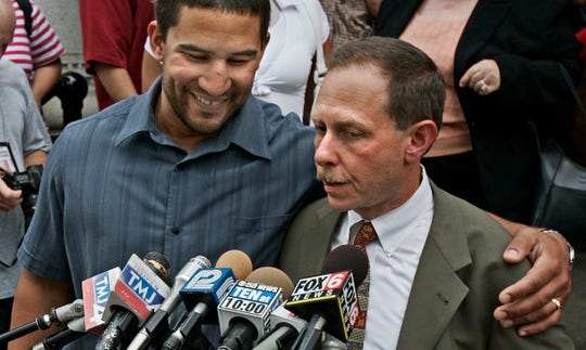 Frank Jude Jr. puts his arm around his lawyer, Jonathan Safran, at a news conference outside the Federal Courthouse after three Milwaukee police officers were convicted of violating his civil rights July 26, 2007.