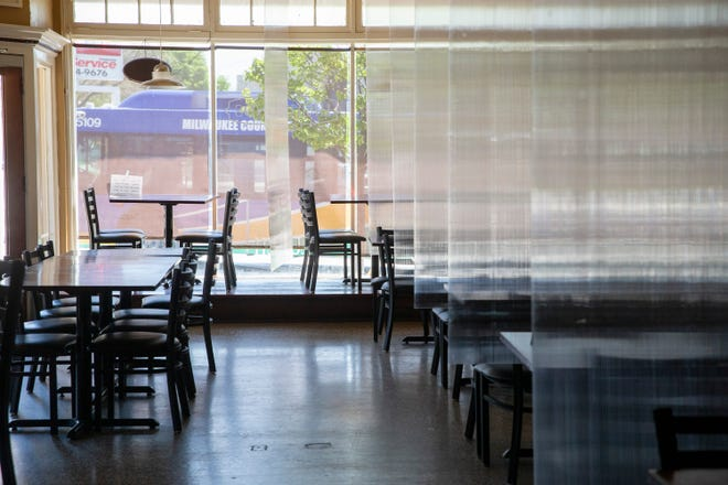 Before opening the dining room May 28, the owners of Highlands Cafe at 1413 N. 60th St. installed clear plastic between dining tables to offer customers some protection as the coronavirus pandemic continues.