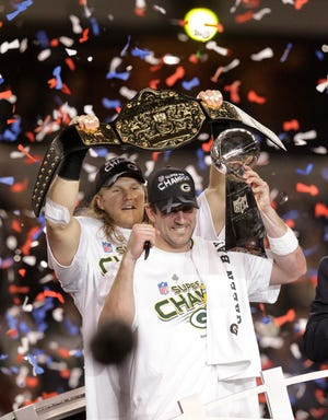 Aaron Rodgers, right, and Clay Matthews celebrate the Packers' victory and Rodgers' MVP award after they beat the Steelers in Super Bowl XLV.