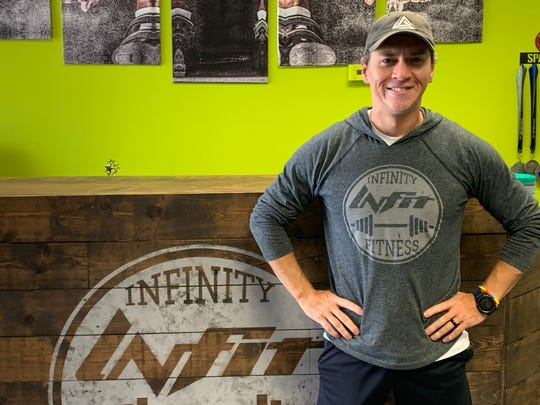 INFIT Monroe, owned by Cesar (pictured) and Allison Camacho, is one of several fitness facilities to reopen following the stay-at-home order.