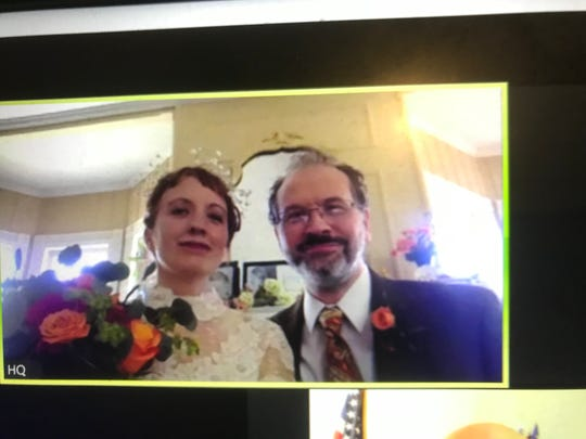Heather Quinlan and Adam McGovern in their Mount Tabor, Parsippany home as Mayor Michael Soriano conducts their 'virtual' online wedding.