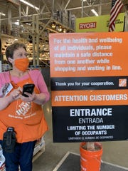 Signs and floor markings remind shoppers to keep their distance from one another in Home Depot stores, which were classified as essential businesses in New Jersey during the stay-at-home order issued by the governor.