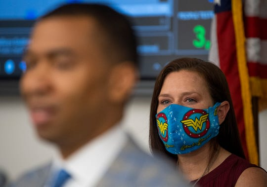 Montgomery EMA Director Chrtistina Thornton looks on as Montgomery Mayor Steven Reed speaks at a coronavirus update briefing at the Emergency Operations Center in Montgomery, Ala., on Wednesday May 20, 2020.