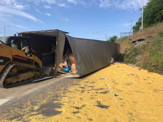 Crews with the Tennessee Department of Transportation work to clear a dry pasta spill blocking traffic on I-24 Wednesday, May 20, 2020