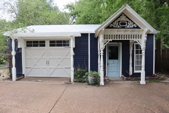 The cottage has a garage-carriage house, an antique kitchen and two fenced areas.