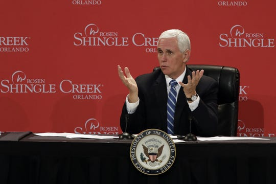 Vice President Mike Pence gestures as he participates in a roundtable discussion Wednesday, May 20, 2020, in Orlando with hospitality and tourism industry leaders to discuss their plans for re-opening during the coronavirus outbreak.