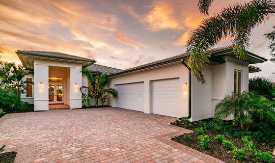 London Bay Home's Langston model offers maintenance-free living in the Cabreo neighborhood of single-family lake and preserve view luxury villas in Mediterra.