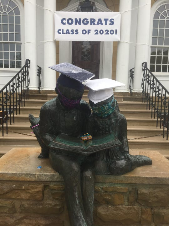 The statues in front of the Granville Library, masked, celebrate the Class of 2020 amid the current pandemic.