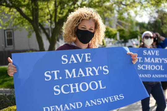 Lily Vasquez of Pompton Lakes, who has two children, ages 3 and 5, enrolled at St. Mary's School, protests the school's closing on Wednesday, May 20, 2020.