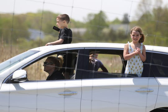 A procession of cars gave kids an opportunity to get out for the day to see some of the farm's 200 animals as families drove through Brookhollow's Barnyard in Boonton on May 20, 2020.