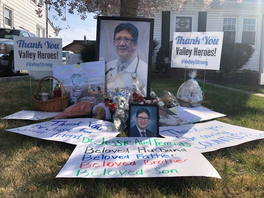 A tribute to Dr. Jessie A. Ferreras, on the front lawn of his home, prepared by Valley Medical Group employees after his death on April 3 from coronavirus complications.