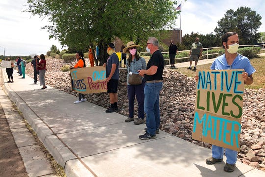 In this May 8, 2020, photo, medical staff from Rehoboth McKinley Christian Hospital including physician Neil Jackson, right, hold a protest over working conditions and depleted staff in Gallup, N.M. Many nurses and doctors say staffing at the hospital was inadequate because of hospital CEO David Conejo's move to cut back on nurses in the first week of March to offset declining hospital revenues after elective surgeries were suspended. They voiced their discontent at the recent protest calling for his resignation.