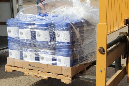 Ogden's Own Distillery of Ogden, Utah delivers 485 gallons of hand sanitizer for distribution on Tuesday,  May 19, 2020, at the Navajo Engineering and Construction Authority warehouse in Shiprock.
