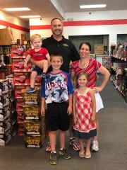 Eric and Jessica Konopka, owners of Michigan Fireworks Company, with their children.