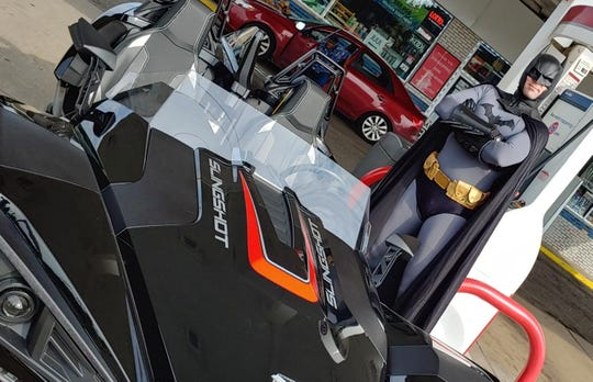 Batman, aka Tom Burger, pumps his own gas when the batmobile is getting close to empty.