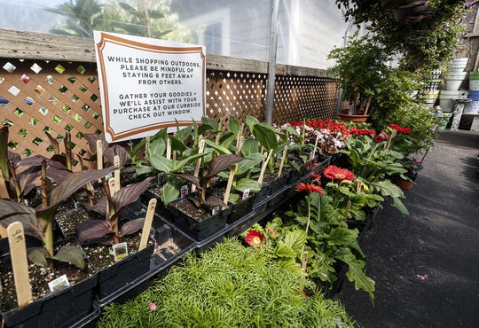 A sign suggests how to shop Wednesday at House of Flowers in Oshkosh.