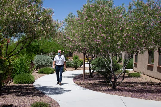 Owner Bobby Larson walks through the back common area on May 20, 2020, at The Villas at Green Valley.