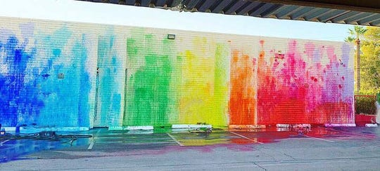 Goolam Saber has worked with the Arizona Science Center and Phoenix charter school Create Academy. Together withstudents, he created this watercolor mural outside the Academy by throwing colorful paint-filled balloons on a white wall.