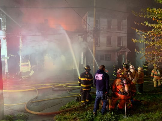 Firefighters respond to a blaze on Duane Street in the City of Poughkeepsie on May 19, 2020.