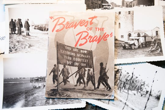 "Various photographs from World War II are seen inside Dale Chapman's Lebanon, Pa., apartment on Monday, May 18, 2020. Included is a small booklet titled ""Bravest of the Brave"" which was published in 1945 and details the history of the 95th Infantry Division."