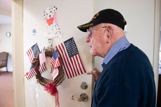 World War II veteran Dale Chapman keeps the door to his Lebanon, Pa., apartment adorned with American flags year-round. Chapman enlisted in the U.S. Army at 21 and served from 1941 to 1945.