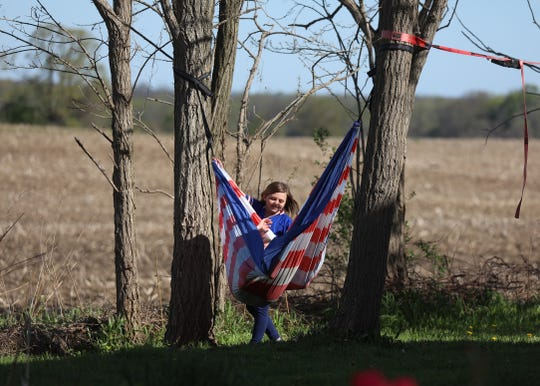Montana Beach wraps up Raeleigh Swatford in a hammock at Elizabeth George's home in Avon on Wednesday, May 20, 2020.  George was watching a couple of her friends' children while they worked.