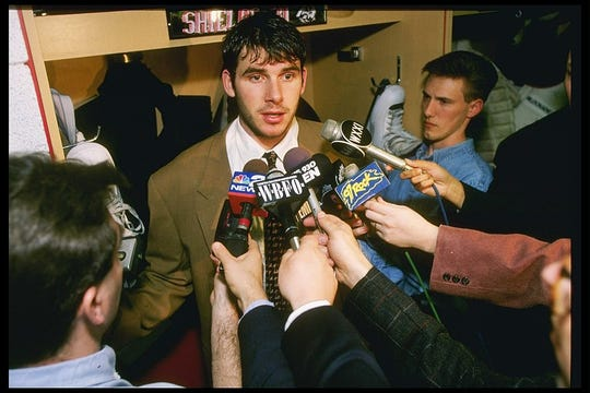 Goaltender Steve Shields of the Buffalo Sabres speaks to reporters after the Sabres eliminated the Senators. That's D&C reporter Sal Maiorana in the lower left corner.