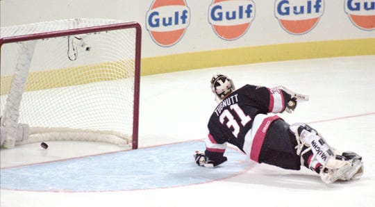 Ottawa Senators goalie Ron Tugnutt watches the Buffalo Sabres winning goal slide into the net off the stick of Derek Plante.