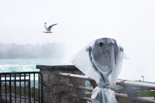 A seagull flies over Niagara Falls on Friday, May 1, 2020. Tower viewers were covered in plastic to discourage visitors from touching them during the coronavirus pandemic.