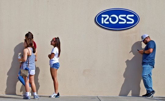 People wait in line to get into Ross Dress for Less in San Angelo on Wednesday, May 20, 2020.