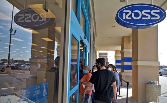 People waiting in line enter the Ross Dress for Less store in San Angelo on Wednesday, May 20, 2020.
