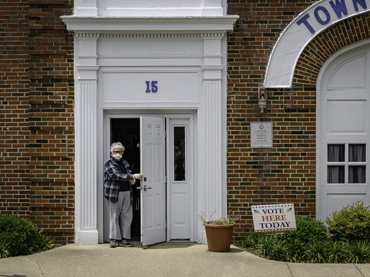 A voter leaves Town Hall in Onancock where in-person voting took place for local election on Tuesday, May 18.