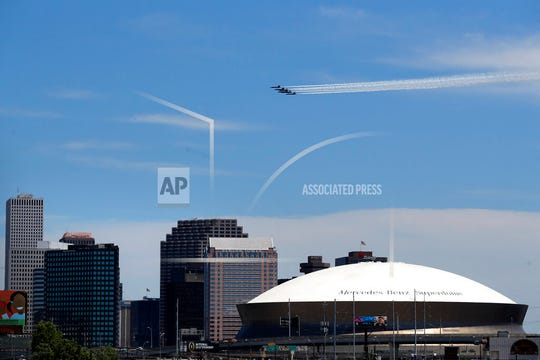 The Blue Angels, the U.S. Navy flight demonstration squadron, flies over downtown New Orleans and the Mercedes-Benz Superdome, as a salute to the health care front line responders working to help the sick during the coronavirus pandemic, Wednesday, May 6, 2020.