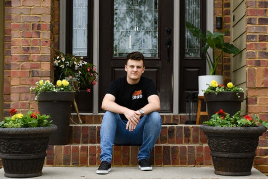 Kaleb Kading Baker, Roosevelt senior, sits for a portrait on Tuesday, May 19, on his front porch in Sioux Falls.