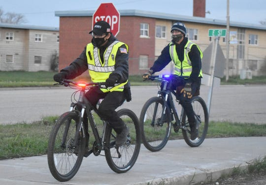 The Cheyenne River Sioux Tribe has hired more than 30 new officers, including some who patrol on bicycles, to enforce curfew, serve as security guards at local grocery stores and secure quarantine sites in Eagle Butte.