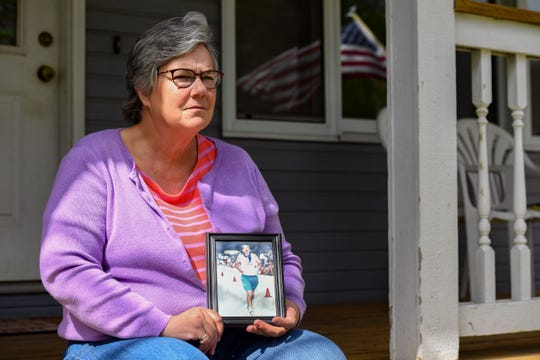 Jan Shafer holds a photo of her father, John Jones, on Wednesday, May 20, on her front porch in Sioux Falls.