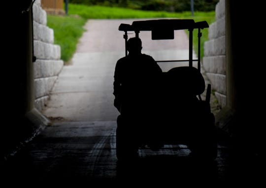 Justin Arlt rides around the course on Wednesday, May 20, 2020 at Prairie Green Golf Course in Sioux Falls, S.D.