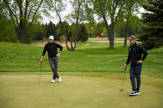 Jake Steffen and Matt Rollag watch a fellow golfer on Wednesday, May 20, 2020 at Prairie Green Golf Course in Sioux Falls, S.D.