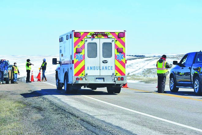 An ambulance is waved immediately through a highway checkpoint operated by the Cheyenne River Sioux Tribe. Tribal leaders say the checkpoints help control the flow of people onto and off of the reservation and gather critical health information to maintain the safety of residents on the reservation amid the COVID-19 pandemic.