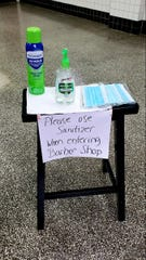 Danny Moats placed hand sanitizer and extra masks outside the entrance of  D. Moats Barber Shop in Staunton.
