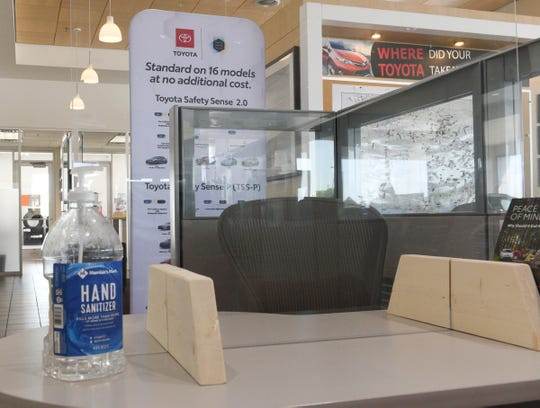 Shields have been installed at desks around St. Cloud Toyota Wednesday, May 20, 2020, in Waite Park.