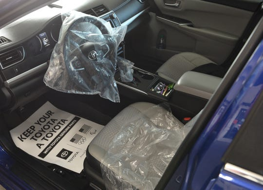 Seats, steering wheels and gear shifters are covered and sanitized on each vehicle that comes into St. Cloud Toyota Wednesday, May 20, 2020, in Waite Park.