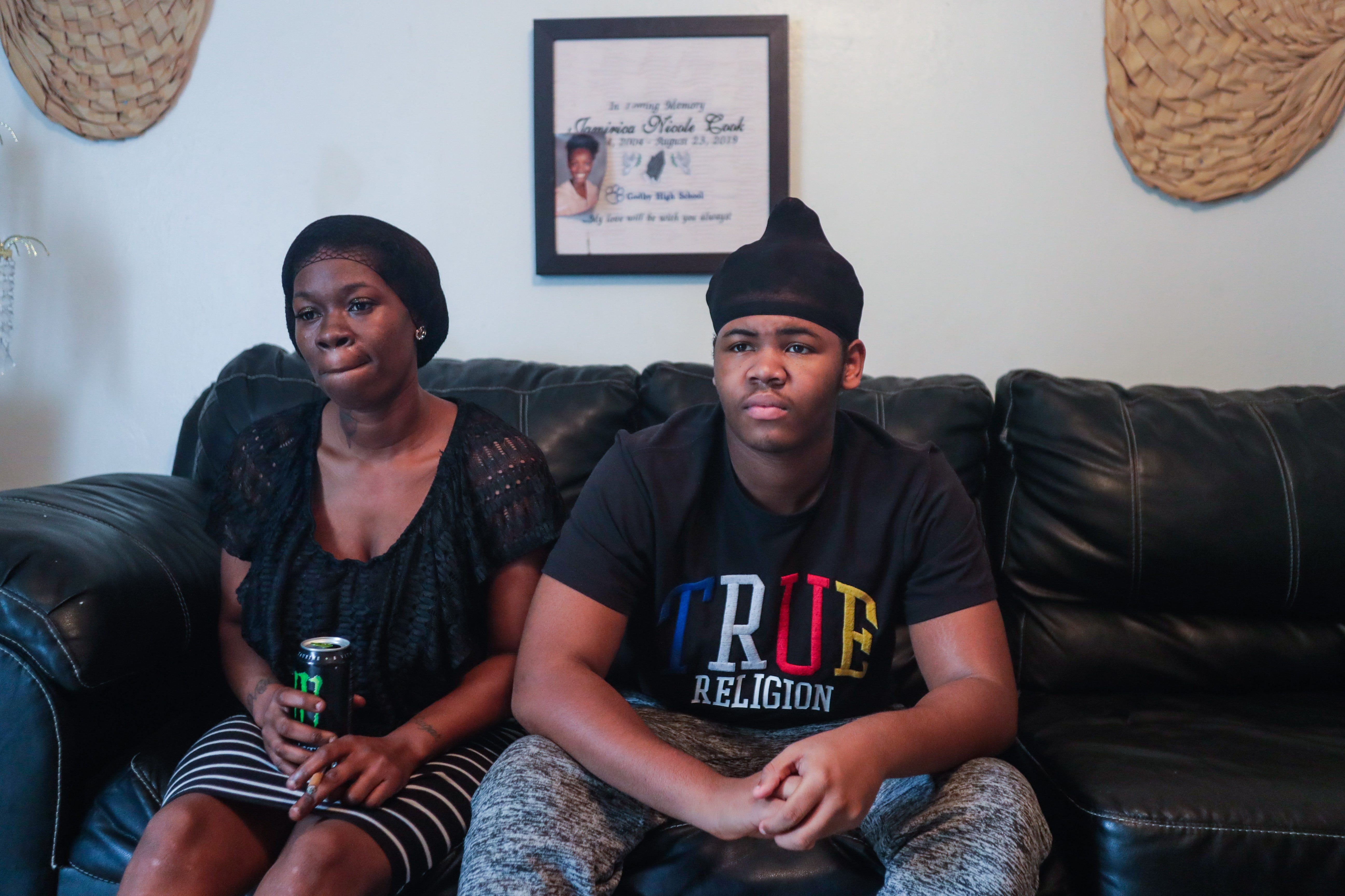 Koquisha Cook, 36, sits with her son Matthew Cook, 17, in their living room. Matthew is facing charges on the shooting and killing of his sister last year.