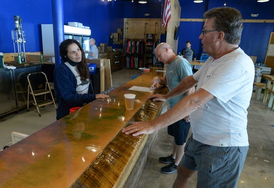 Sailfish Brewing Company in Fort Pierce was ordered by the state Department of Business and Professional Regulation to shut down its taproom for on-premise consumption on Saturday night — for the third time during the coronavirus pandemic. In this photo, Danielle West (left), tap room manager, talks with her customer Jay Weeks (right), of Jensen Beach, inside the taproom on Wednesday, May 20, 2019.